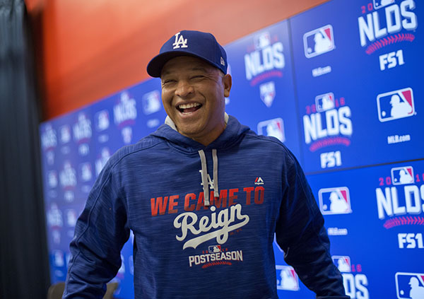 Los Angeles Dodgers manager Dave Roberts smiles after answering questions at a media availability before Game 5 of baseball's National League Division Series against the Los Angeles Dodgers, at Nationals Park, Thursday, Oct. 13, 2016, in Washington. (AP Photo/Pablo Martinez Monsivais)