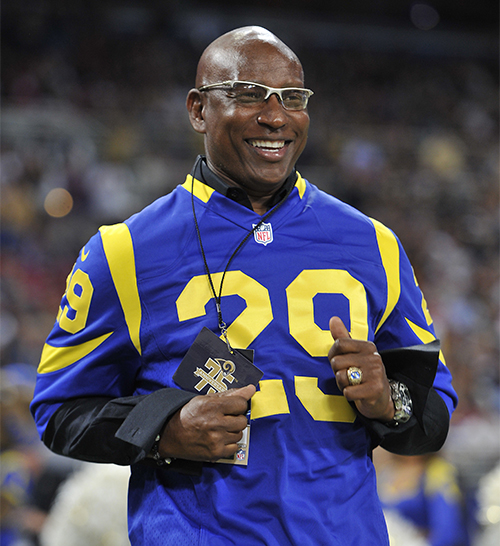 Former player and member of the Rams franchise 75th Anniversary team Eric Dickerson acknowledges the crown during a halftime ceremony during an NFL football game against the San Francisco 49ers on December 2, 2012 in St. Louis. The Rams won in overtime, 16-13 (AP Photo/G. Newman Lowrance)