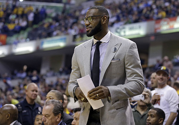 Cleveland Cavaliers forward LeBron James watches from the bench during the first half of the team's NBA basketball game against the Indiana Pacers in Indianapolis, Wednesday, Nov. 16, 2016. (AP Photo/Michael Conroy)