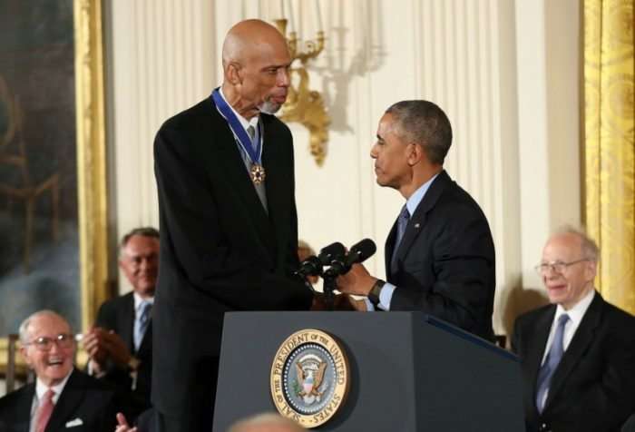 ormer NBA basketball player Kareem Abdul Jabbar, left, is presented the Presidential Medal of Freedom by President Barack Obama, right, during a ceremony in the East Room of the White House, Tuesday, Nov. 22, 2016, in Washington. Obama is recognizing 21 Americans with the nation's highest civilian award, including giants of the entertainment industry, sports legends, activists and innovators. (AP Photo/Andrew Harnik)