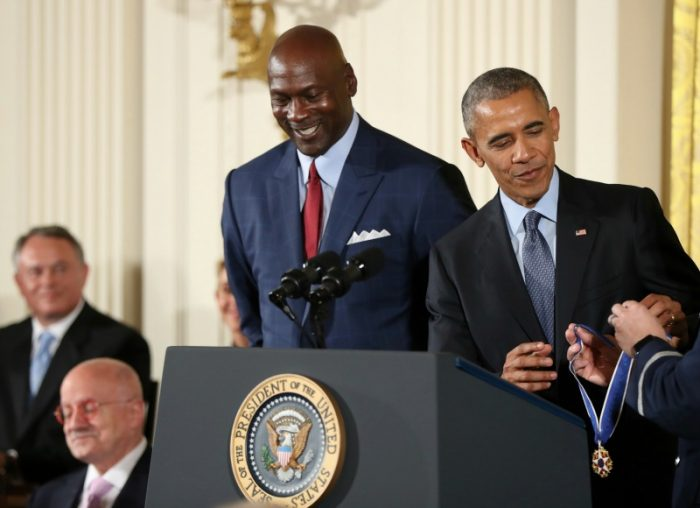 President Barack Obama presents the Presidential Medal of Freedom to former NBA basketball player Michael Jordan during a ceremony in the East Room of the White House Tuesday, Nov. 22, 2016, in Washington. Obama is recognizing 21 Americans with the nation's highest civilian award, including giants of the entertainment industry, sports legends, activists and innovators. (AP Photo/Manuel Balce Ceneta)