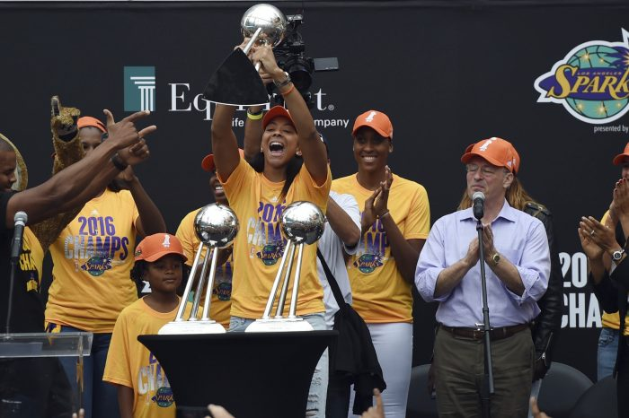 Los Angeles Sparks' Candace Parker holds the WNBA Championship trophy during a celebration to honor their winning at Chick Hearn Court at LA Live in Los Angeles, Monday, Oct. 24, 2016. (Hans Gutknecht/Los Angeles Daily News via AP)