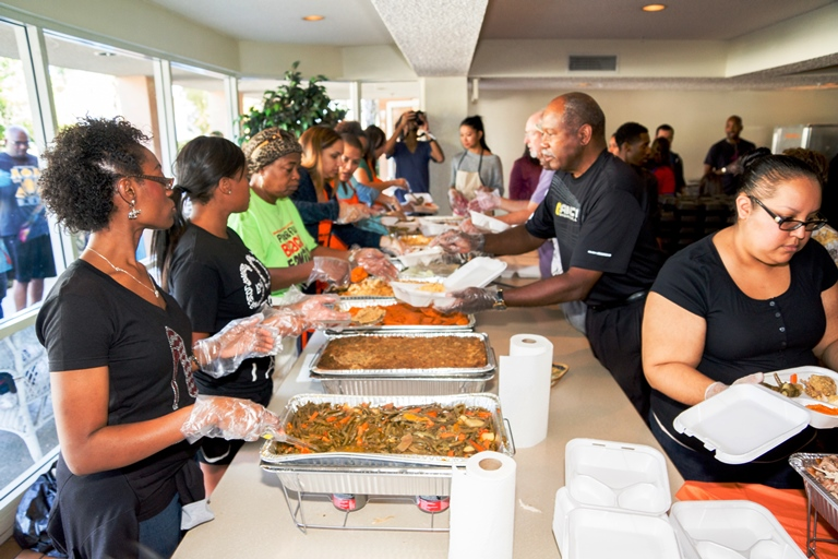 Mothers In Action and volunteers are just one of many organizations bringing Thanksgiving to deserving families in South L.A.