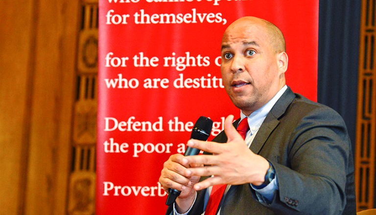New Jersey Senator Cory Booker is among five prominent senators to sign a letter urging accountability in the federal government's advertising practices. This photo was taken during a panel discussion on criminal justice reform with Senators Cory Booker (D-N.J.) and Tim Scott (R-S.C.). (Freddie Allen/AMG/NNPA)