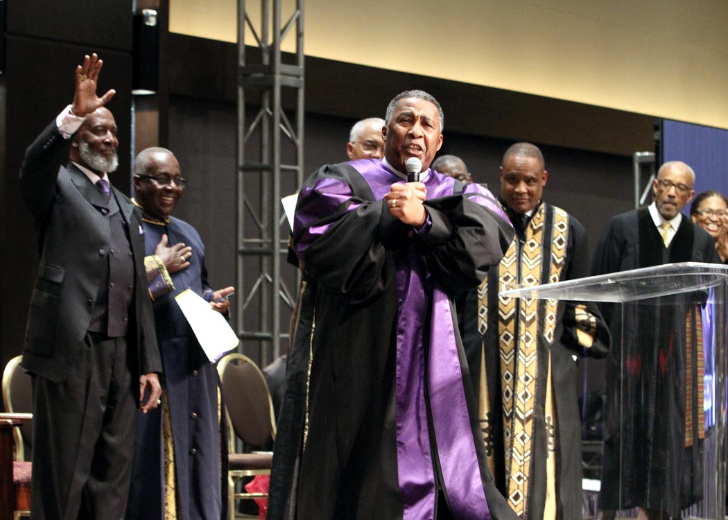 Bishop Clement Fugh, right, preaches on Oct. 30 at the Closing Worship and Commissioning Service. Looking on, from left, are Bishop John Bryant, Presiding Elder Roosevelt Lindsey and other AME ministers. (Clayton Everett/FAME Church)