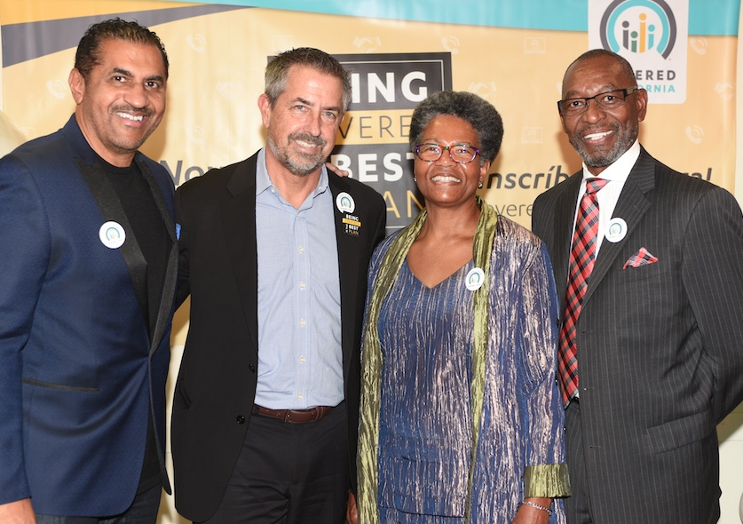 From left are Aundrae Russell of 102.3 KJLH, Peter V. Lee, executive director of Covered California, Community Activist Avis Ridley-Thoma and, the Rev. Benjamin Hollins, pastor of Price Chapel AME Church. (Photo by Ian Foxx)