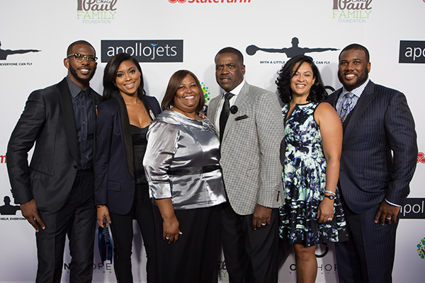 "Chris Paul & Family: (L-R) Chris Paul, Jada Paul (wife), Charles Edward Paul (father) Robin Jones Paul (mother), Deserie Paul (sister-in-law) and Charles ""CJ"" Paul (brother). (Courtesy Photo)"