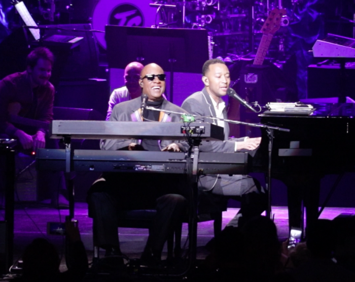 "Stevie Wonder and John Legend perform ""Ordinary People"" at Stevie's 20th Annual House Full of Toys Benefit Concert at Microsoft Theater on Dec. 9, 2016 in Los Angeles. (Brittany K. Jackson photo)"