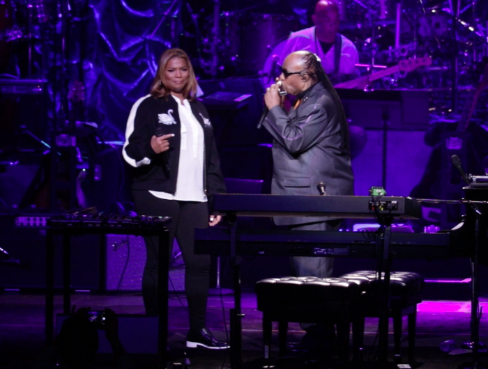 "Queen Latifah & Stevie Wonder perform ""Georgia Rose"" at Stevie's 20th Annual House Full of Toys Benefit Concert at Microsoft Theater on Dec. 9, 2016 in Los Angeles. (Brittany K. Jackson photo)"