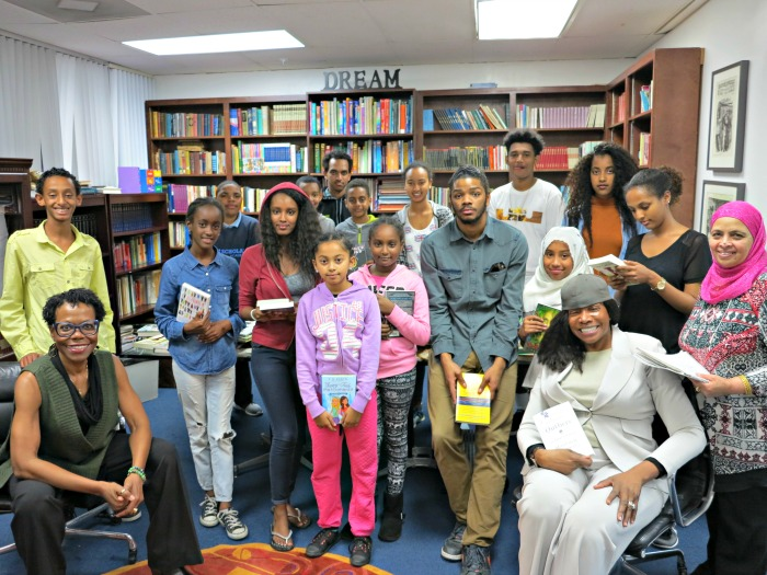 Educating Young Minds students and tutor. Seated far left Board President Karen A. Clark and seated far right founder Angeles Echols-Brown. (Courtesy Photo)