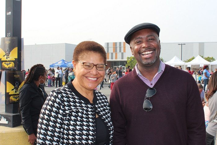 Holiday Cheer: Councilmember  Harris-Dawson and Congressmember Karen Bass smile for the camera as they bring Christmas festivities to South LA children. (Courtesy Photo)