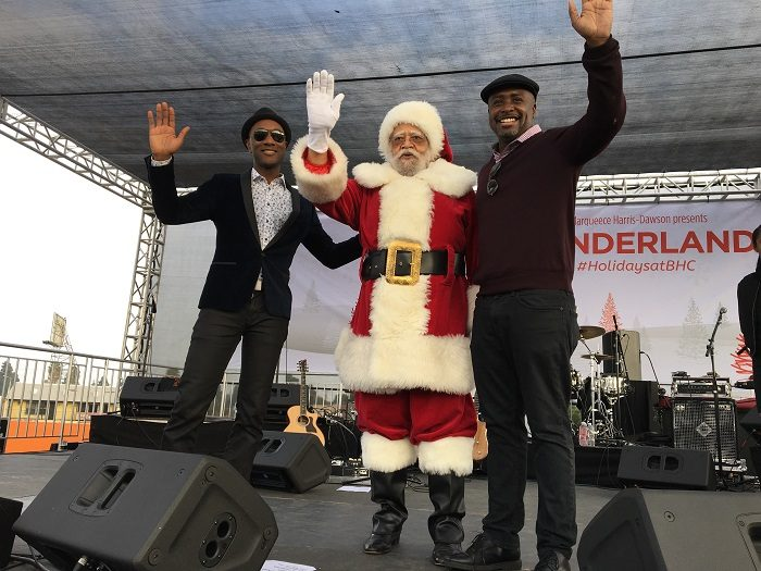 Santa came to town: Councilmember, Santa Claus, and Aloe Blacc cheer on the Crenshaw community. (Courtesy Photo)