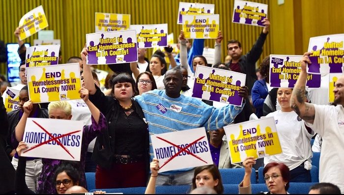 Activists demonstrate during a recent L.A. County Board of Supervisors meeting