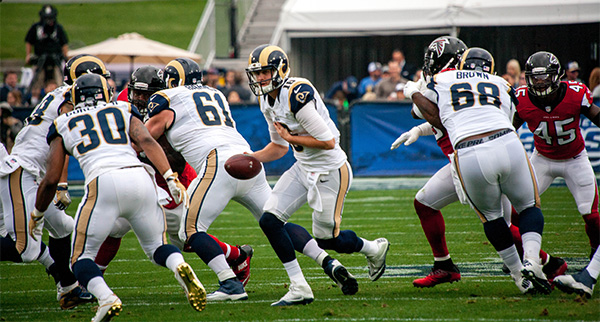 quarterback Jared Goff (#16) hands ball off to running back Todd Gurley (#30) (Robert Torrence/L.A. Sentinel)