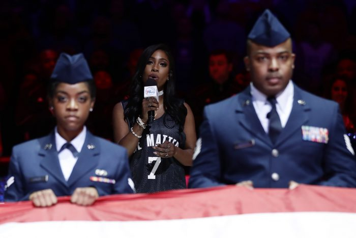 Sevyn Streeter, center, sings the national anthem before an NBA basketball game between the Philadelphia 76ers and the Los Angeles Lakers, Friday, Dec. 16, 2016, in Philadelphia. (AP Photo/Matt Slocum)