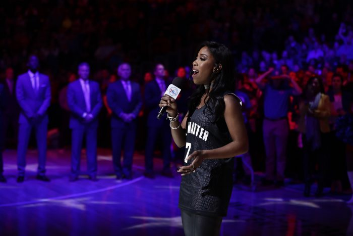 Sevyn Streeter sings the national anthem before an NBA basketball game between the Philadelphia 76ers and the Los Angeles Lakers, Friday, Dec. 16, 2016, in Philadelphia. (AP Photo/Matt Slocum)
