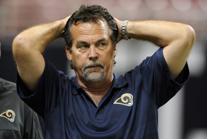 FILE - In this Aug. 29, 2013, file photo, St. Louis Rams head coach Jeff Fisher looks on before the start of a preseason NFL football game between the Rams and the Baltimore Ravens in St. Louis. The Rams have squandered nice cushions their last two home games, the latest against the 49ers on Monday night, Oct. 13, 2014. Year 3 under coach Fisher thus far has been a bust.  (AP Photo/Bill Boyce, File) ORG XMIT: NY158