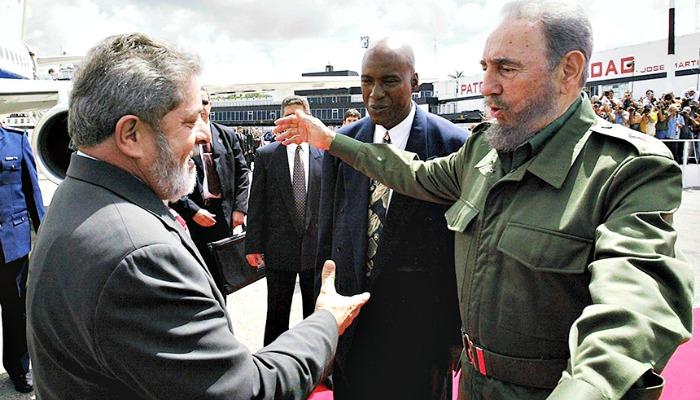 Harry Alford says that there are few individuals in modern history as controversial as Fidel Alejandro Castro Ruz. In this 2003 photo, Cuba's Fidel Castro (right) greets Luiz Inácio Lula da Silva of Brazil. (Antônio Milena/ABr/Wikimedia Commons)