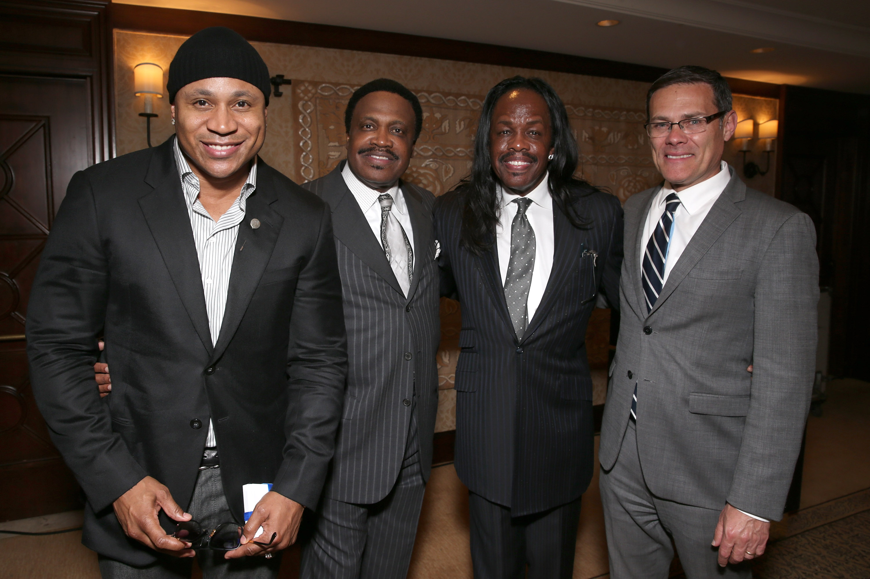 """BEVERLY HILLS, CA - MAY 18: LL Cool J, Dr. Kenneth C. Ulmer, Verdine White and Consul General of Isreal David Siegel attend the The Ulmer Institute Launch Celebration at Montage Beverly Hills on May 18, 2016 in Beverly Hills, California. (Photo by Todd Williamson/Getty Images for The Ulmer Institute)"""