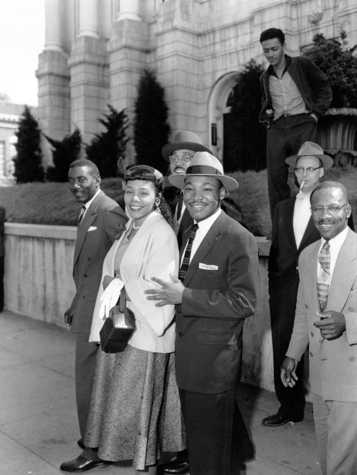 Rev. Dr. Martin Luther King Jr., and his wife, Coretta, are shown outside Circuit Court in Montogomery, Al. on March 22, 1956. The Reverend was found guilty of conspiring the Montgomery Bus Boycott that began Dec. 5, 1955. The others are not identified. (AP Photo/Gene Herrick)