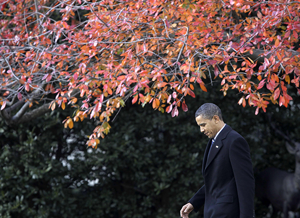 President Barack Obama walks across the South Lawn of the White House in Washington, Monday, Dec. 6, 2010, to board Marine One helicopter as he travels to Winston-Salem, N.C. (AP Photo/Charles Dharapak)