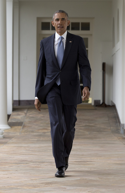 President Barack Obama walks along the colonnade of the White House in Washington, Tuesday, Jan. 12, 2016, to the residence from the Oval Office, hours before giving his State Of The Union address. (AP Photo/Carolyn Kaster)