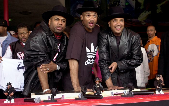 "Hip hop pioneers RUN-DMC create handprints in cement as they are  inducted into Hollywood's RockWalk Monday, Feb. 25, 2002, in Los Angeles. Jason ""Jam Master Jay"" Mizell, left, Darryl ""DMC"" McDaniels, center, and Joseph ""DJ Run"" Simmons, produced the first rap album to go gold as well as the first rap act nominated for a Grammy. (AP Photo/Krista Niles)"