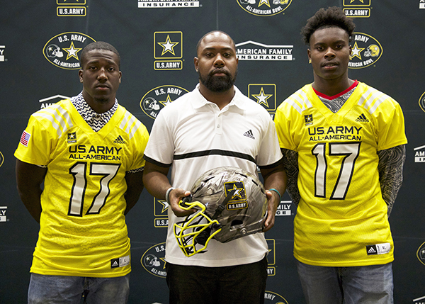 right to left) defensive back Greg Johnson, head coach Mil'Von James, and Joseph Lewis (Isaiah Howard / T.G. Sportstv1)