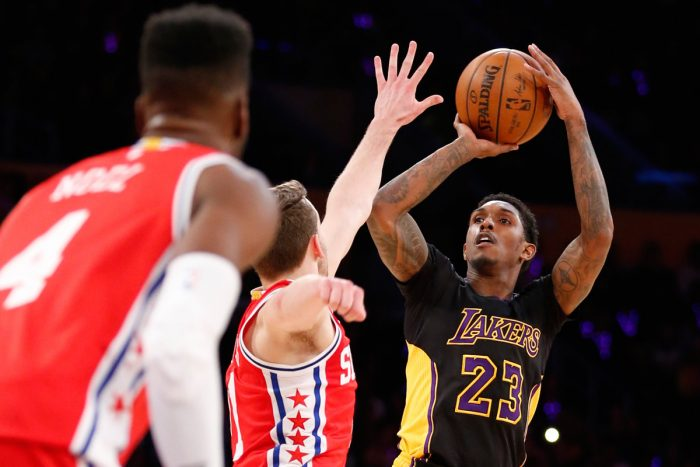 Los Angeles Lakers' Lou Williams shoots the ball against the Philadelphia 76ers during the second half of an NBA basketball game, Friday, Jan. 1, 2016, in Los Angeles. The Lakers won 93-84. (AP PHOTO/DANNY MOLOSHOK)