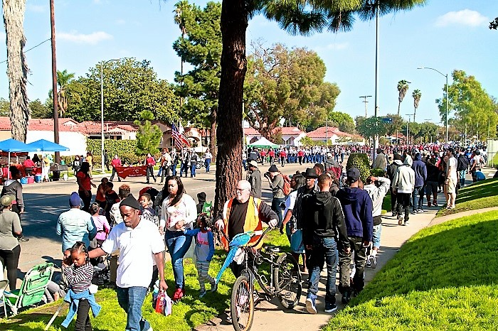 Hundreds line the street as the Kingdom Day Parade marches proudly down MLK Blvd Photo by Mesiyah McGinnis