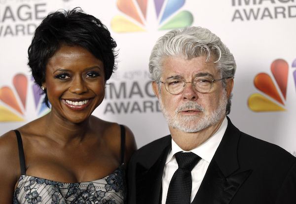 Mellody Hobson, left, and George Lucas arrive at the 43rd NAACP Image Awards on Friday, Feb. 17, 2012, in Los Angeles. (AP Photo/Matt Sayles)
