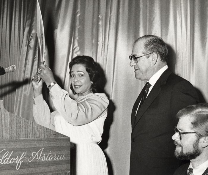 Coretta Scot King stands at the podium beside Murray H. Finley during the Americans for DEmocratic Action Roosevelt-Humphrey Dinner on June 16, 1983 at the Waldord Astoria Hotel in New York City (Ron Gabella/ Wire Image