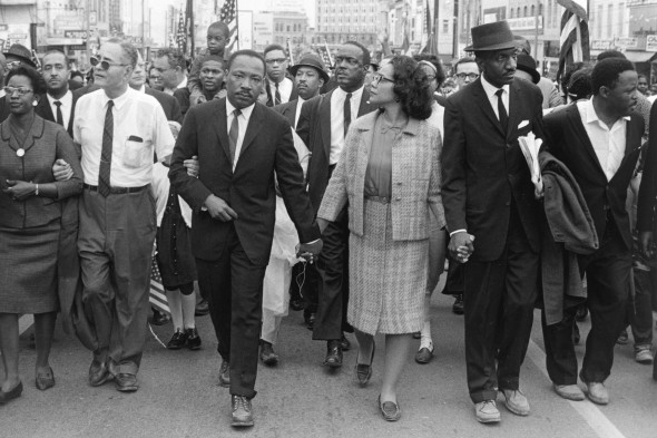 This photo supplied by the High Museum of Art, shows Dr. Martin Luther King Jr. and his wife Coretta Scott King leading freedom marchers in Montgomery, Ala. in 1965, in a photo by Morton Broffman, which is part of one of two exhibits --this one at the High Museum of Art -- opening in Atlanta on Saturday,June 7, 2008,   focusing on the civil rights movement.(AP Photo/ High Museum of Art ,Gift of the Broffman Family,Morton Broffman)