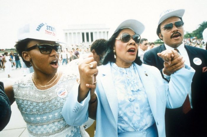 Coretta Scott King, center, holding hands with the her son, Martin Luther King III, right, and her daughter, Bernice, left, during the Hands Across America line near the Lincoln Memorial in Washington, D.C., Sunday, May 25, 1986. Millions of volunteers formed a human chain during a fund-raiser for the homeless and hungry.  (AP PHOTO/REED TOM)