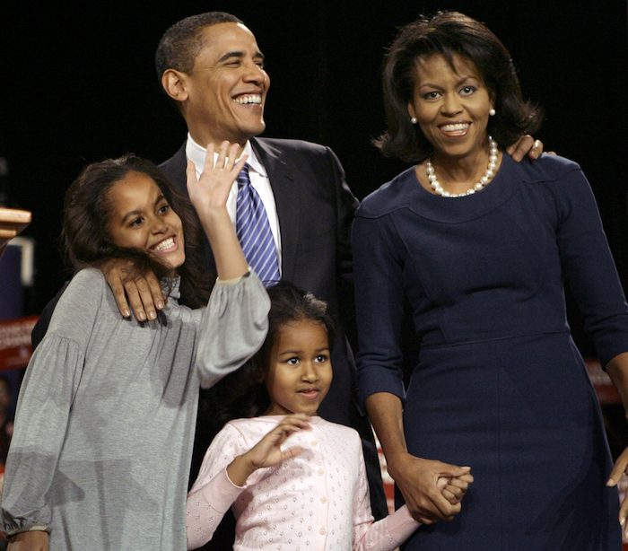 FILE - In this Jan. 3, 2008, file photo Democratic presidential hopeful Sen. Barack Obama, D-Ill., with wife Michelle and daughters Malia ans Sasha, waves to supporters at an rally in Des Moines, Iowa, after winning the Iowa democratic presidential caucus. President Barack Obama's daughter Malia was just 10 and longing for a promised puppy when her family moved into the White House. She's marked some of life's milestones in the past seven years, and another one comes Friday: graduation from high school. (AP Photo/M. Spencer Green, File)