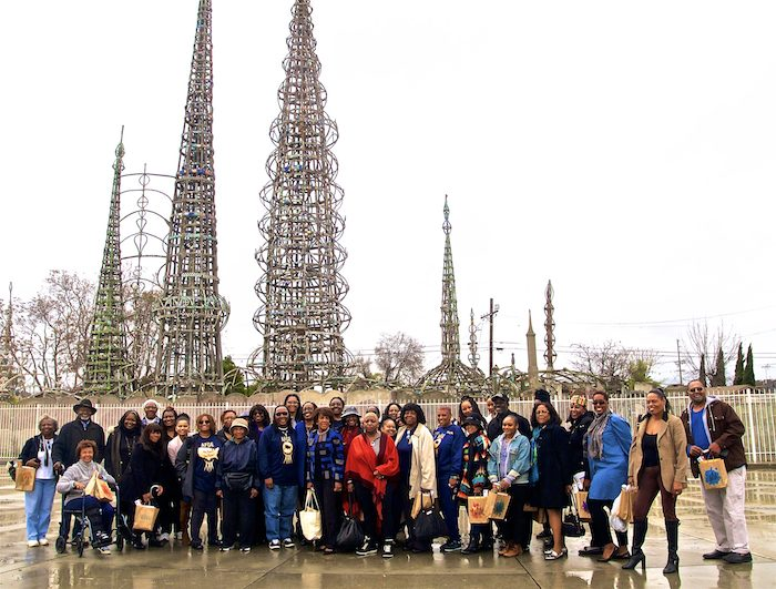 1-Congresswoman Maxine Waters and participants of the Black History Month Museum / Art Gallery Tour, stand in unison, in front of the historical Watts Towers, Saturday, February 19, 2017. (Photo by E. Mesiyah McGinnis for LAWT)