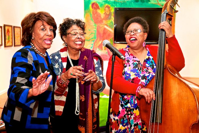 "1-Congresswoman Maxine Waters (left) sings with Watts Tower Arts Center Director, Rosie Lee Hooks (center), and Artist-in residence, Bassist, Nedra Wheeler (right) while visiting the center as part of the Black Women's Forum's, Black History Month Museum / Art Gallery Tour, Saturday, February 19, 2017. Participants visited five museums, with the theme chanted and sang, ""Get on the bus!"" (Photo by E. Mesiyah McGinnis)"