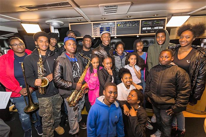 Aloe Blacc poses with music hopefuls on the John Lennon Educational Tour Bus. (Photo Courtesy: John Lennon Educational Tour Bus)