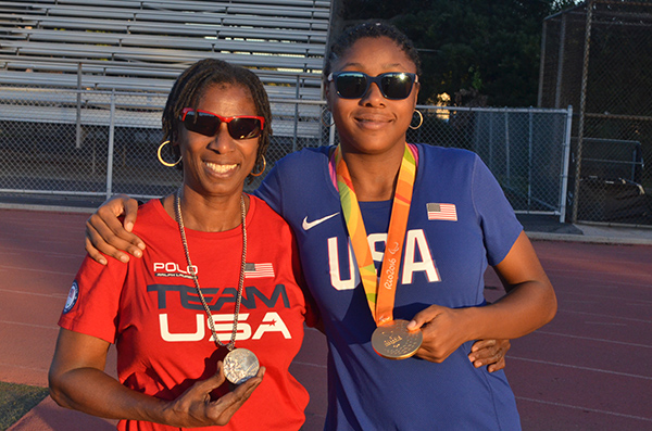Rosalyn Clark (left) poses with Breanna Clark (right) with their Olympic and Paralympic medals. (Amanda Scurlock/ L.A. Sentinel)