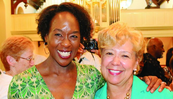"""Hidden Figures"" author Margot Lee Shetterly (left) poses for a photo with New Journal and Guide publisher Brenda Andrews. (Ernest Lowery/New Journal and Guide)"