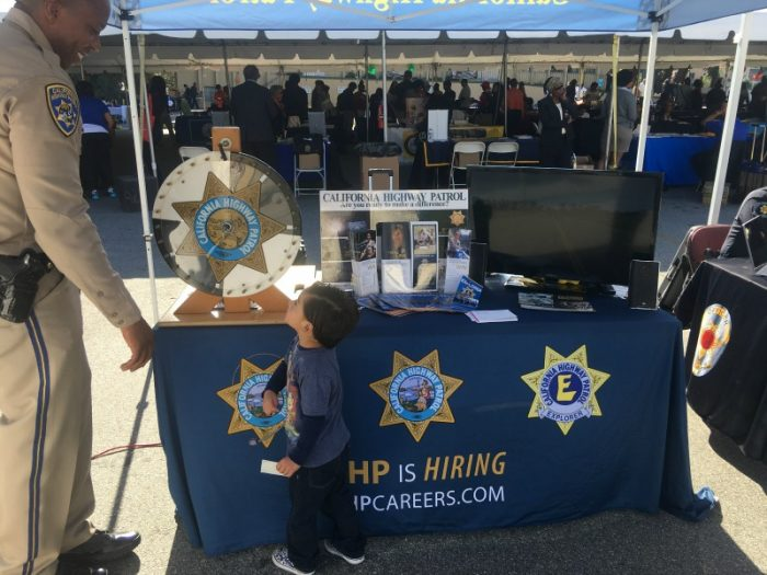 Officer Camrin Servio recruiting a future officer at the Hoops and Options College Fair.(courtesy photo)