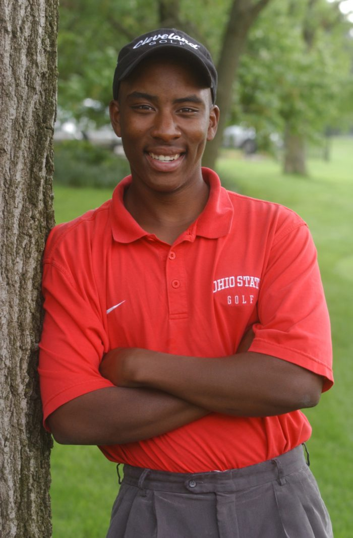 Ohio State golfer Kevin Hall pose for a photo at the school's golf course in Columbus, Ohio, Tuesday, May 18, 2004. Hall, who  has been deaf since a bout with meningitis when he was 2, won medalist honors at the Big Ten tournament two weeks ago by 11 strokes, prompting his fellow competitors to give him a standing ovation at the awards ceremony after the three-day tournament. (AP Photo/Paul Vernon)