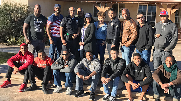 LAPD officers, actress and autism advocate Tisha Campbell Martin, 6th from left, and teens with Autism Spectrum Disorder participate in a weekend of training. (Courtesy Photo)
