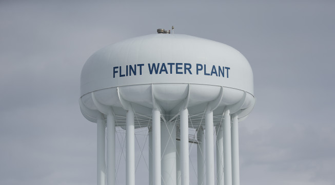 The Flint Water Plant tower is seen, Friday, Feb. 26, 2016 in Flint, Mich. Flint is under a public health emergency after its drinking water became tainted when the city switched from the Detroit system and began drawing from the Flint River in April 2014 to save money. The city was under state management at the time. (AP Photo/Paul Sancya)