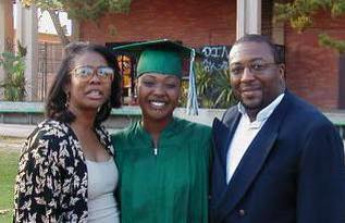 Paris Adkins-Jackson (centered) with her mother and father after graduating from Hamilton High School. (courtesy photo)