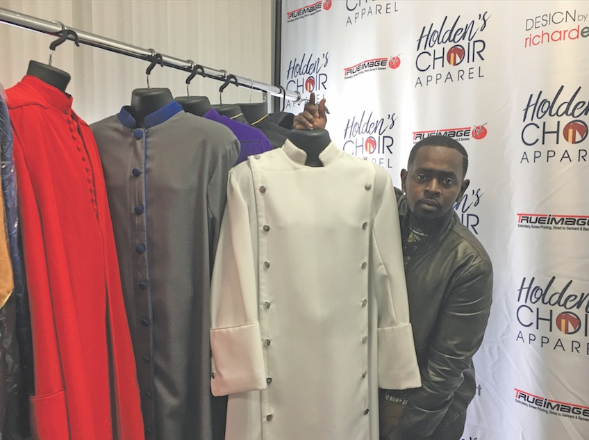 GaShon Holden shows some of his unique robe designs. (photo by Cora J. Fossett)