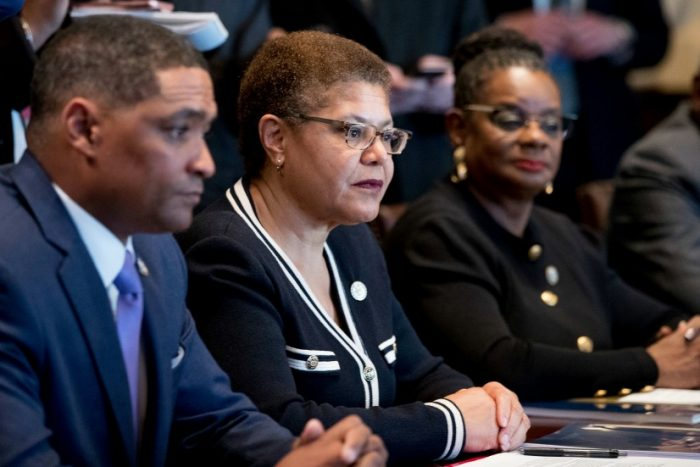 From left, Congressional Black Caucus Chairman Rep. Cedric Richmond, D-La., Rep. Karen Bass, D-Calif., Rep. Gwen Moore, D-Wis., and other members of the Congressional Black Caucus meet with President Donald Trump in the Cabinet Room of the White House in Washington, Wednesday, March 22, 2017. (AP Photo/Andrew Harnik)