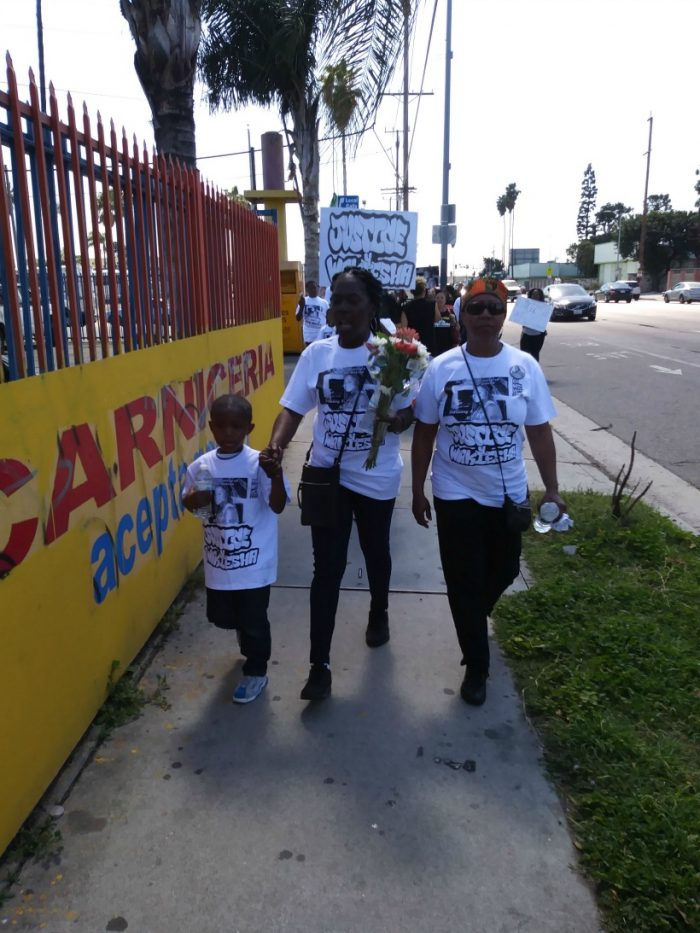 Lisa Hines and family during march for her daughter Wakiesha Wilson. (Photo by Christopher X/In the Works Media)