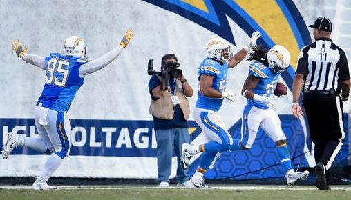 The then San Diego Chargers free safety Dwight Lowery, right, reacts with nside linebacker Manti Te'o (50) and defensive end Tenny Palepoi (95) after scoring a touchdown off a fumble recovery during the second half of an NFL football game against the Tennessee Titans, Sunday, Nov. 6, 2016, in San Diego. (AP Photo/Denis Poroy
