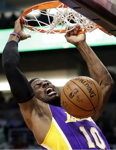 Los Angeles Lakers guard David Nwaba dunks against the Phoenix Suns during the first half of an NBA basketball game, Thursday, March 9, 2017, in Phoenix. (AP Photo/Matt York)